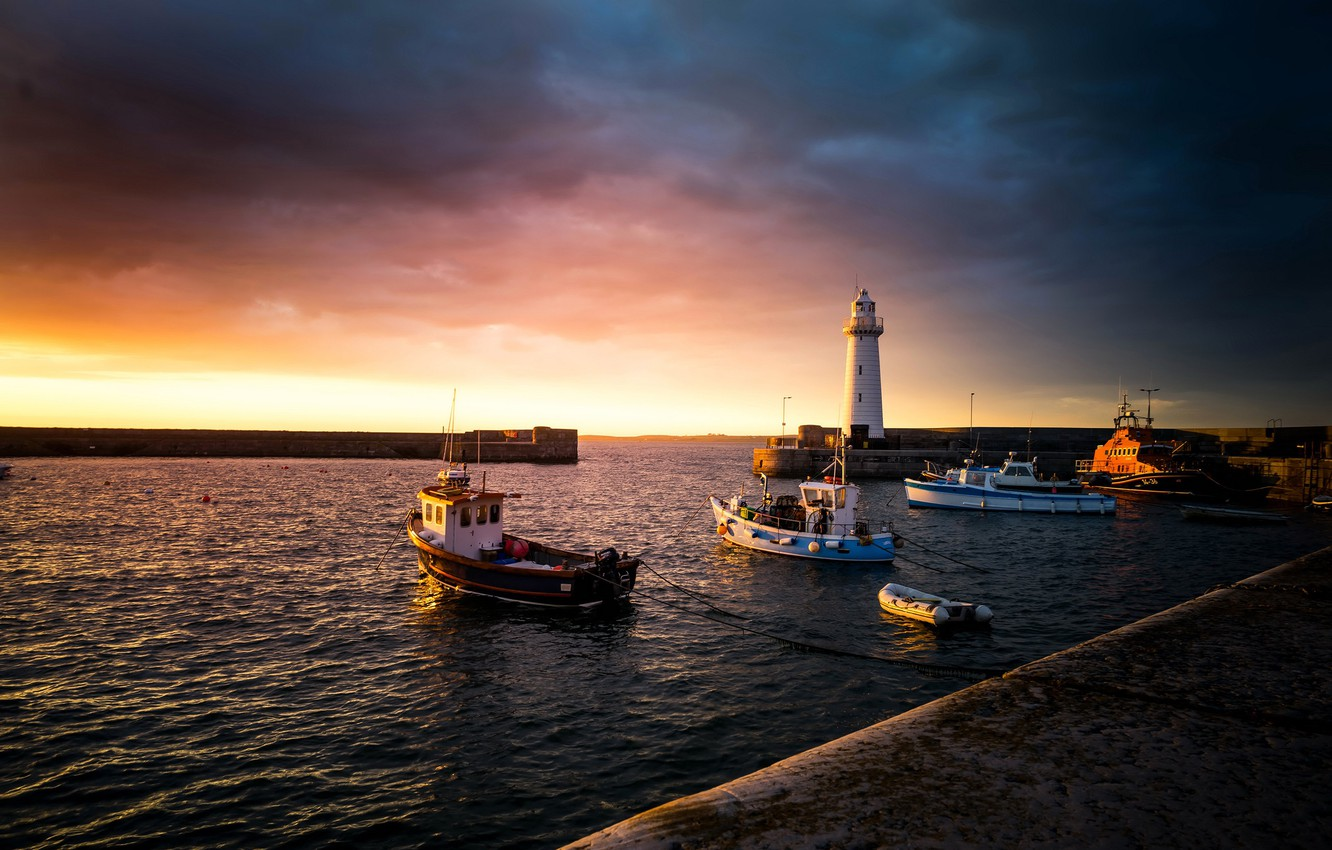 Photo wallpaper sea, the sky, the sun, clouds, sunset, coast, lighthouse, boats, pier, UK, boats, harbour, Northern …