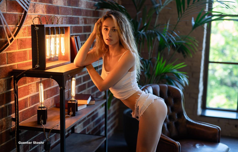 Photo wallpaper ass, look, girl, pose, room, hair, shorts, interior, chair, figure, window, blonde, legs, curls, Guenter …