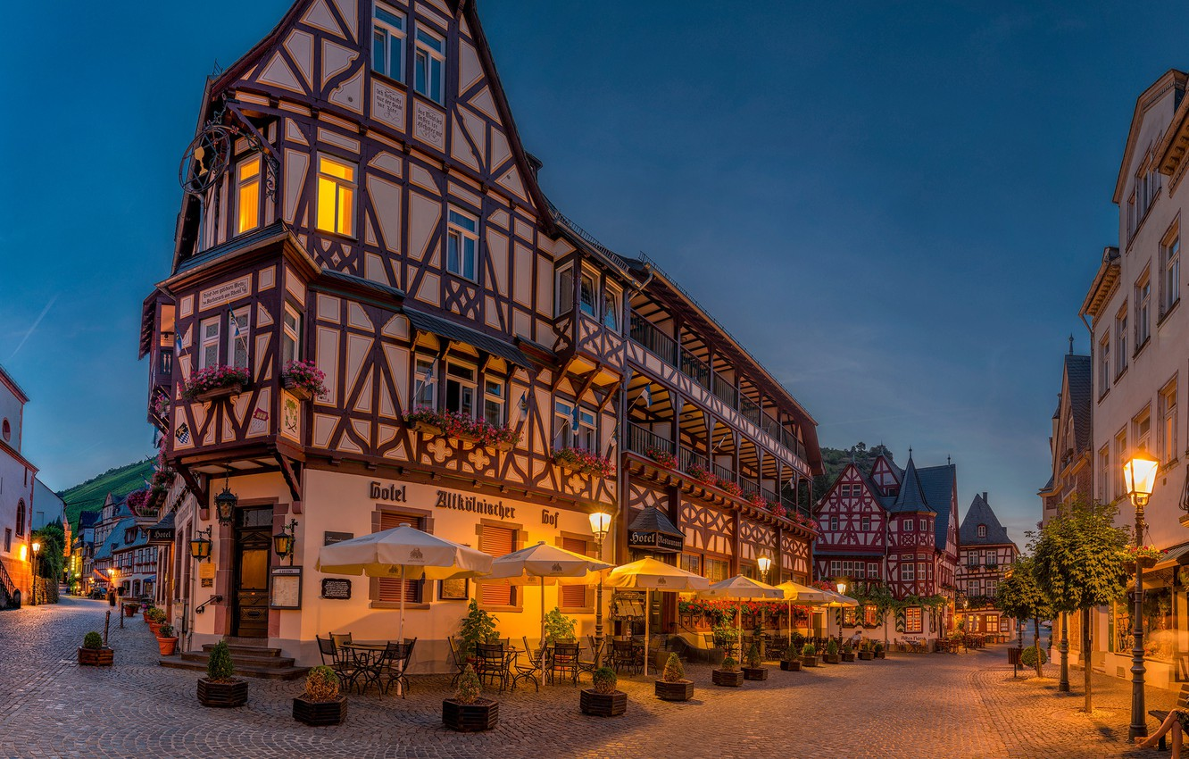 Photo wallpaper trees, lights, chairs, home, the evening, Germany, lights, umbrellas, the bushes, tables, streets, Bacharach