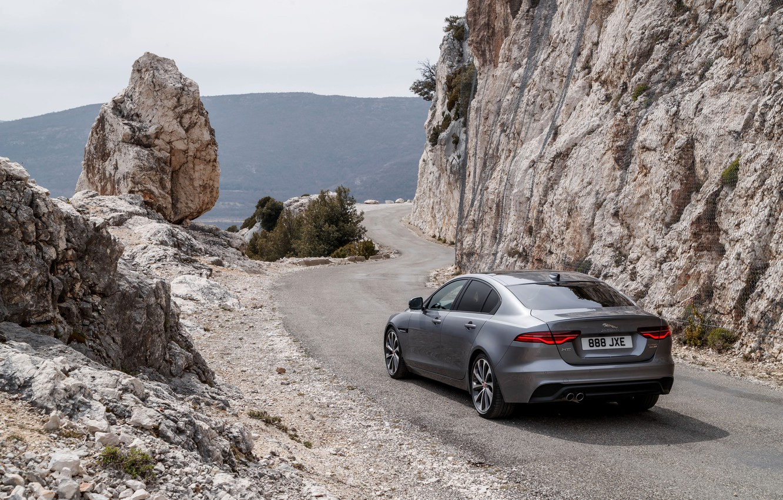 Photo wallpaper road, mountains, rocks, Jaguar, back, 2020, gray-silver, Jaguar XE