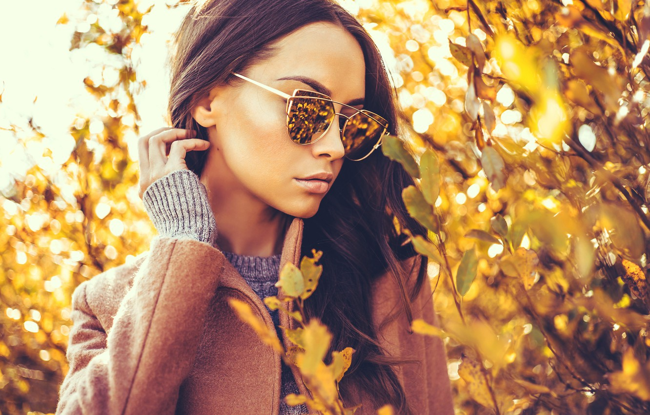 Photo wallpaper autumn, leaves, branches, pose, model, portrait, makeup, glasses, hairstyle, brown hair, coat, yellow, bokeh, jumper