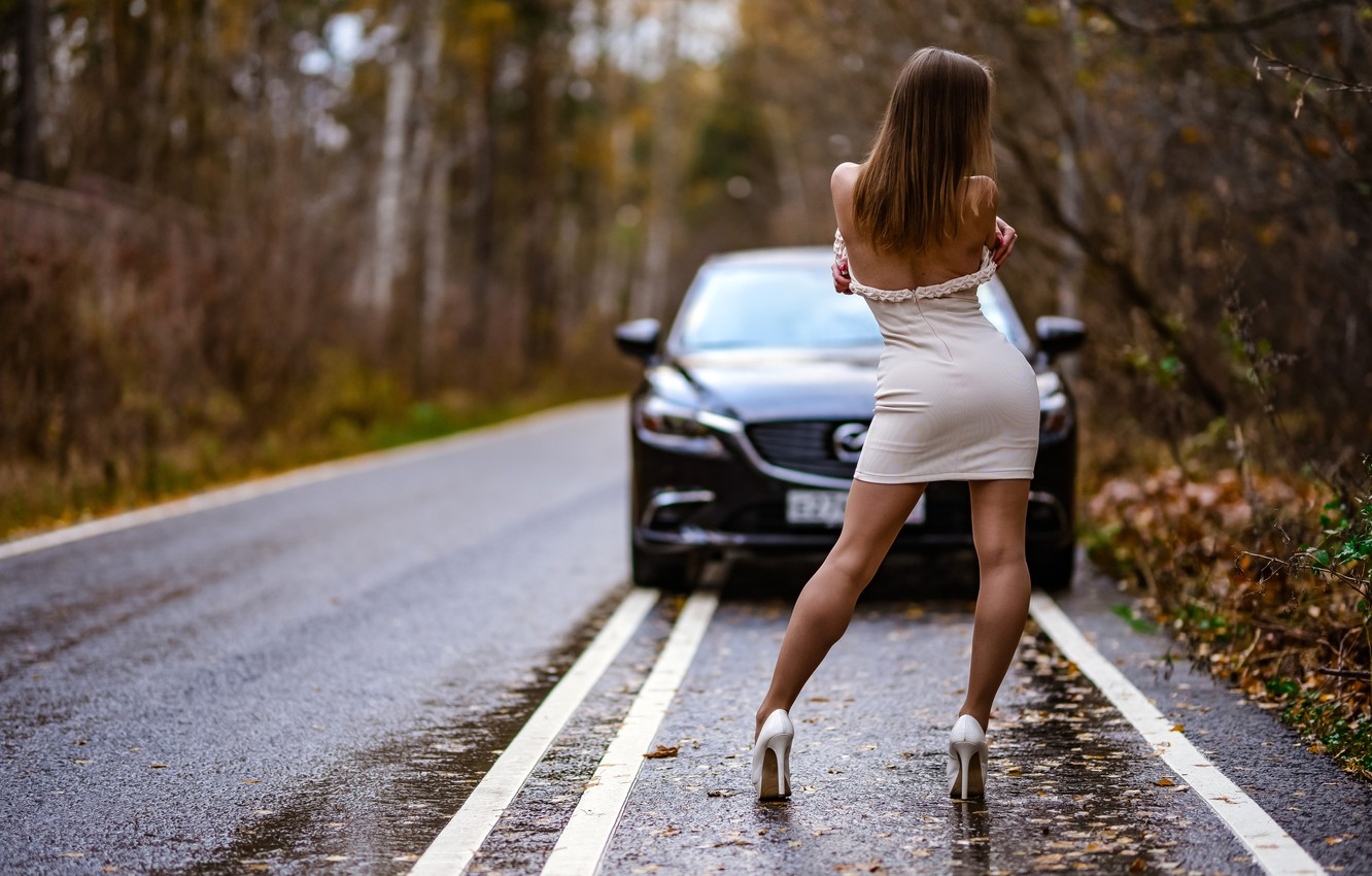 Photo wallpaper road, autumn, forest, leaves, trees, nature, pose, black, model, figure, dress, hairstyle, shoes, brown hair, …