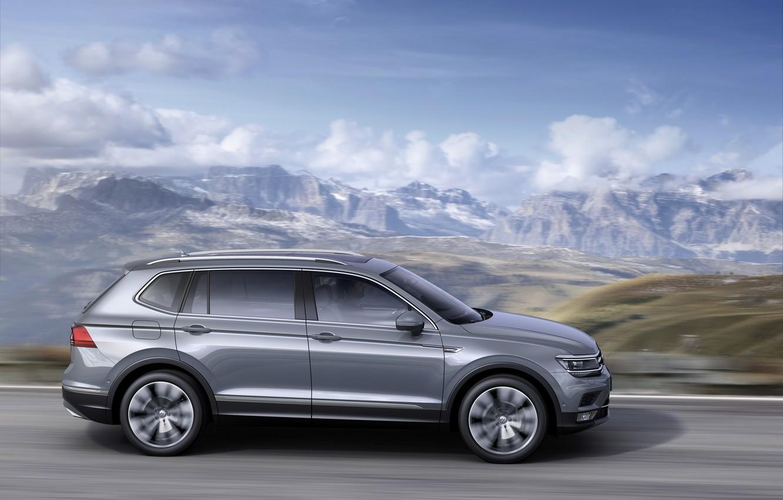 Photo wallpaper clouds, mountains, grey, movement, Volkswagen, Tiguan