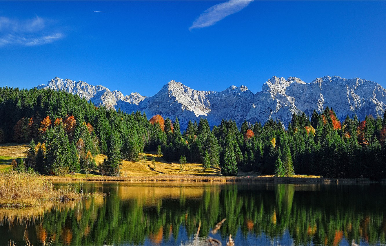 Photo wallpaper autumn, forest, the sky, clouds, light, mountains, nature, lake, reflection, blue, rocks, blue, shore, the …