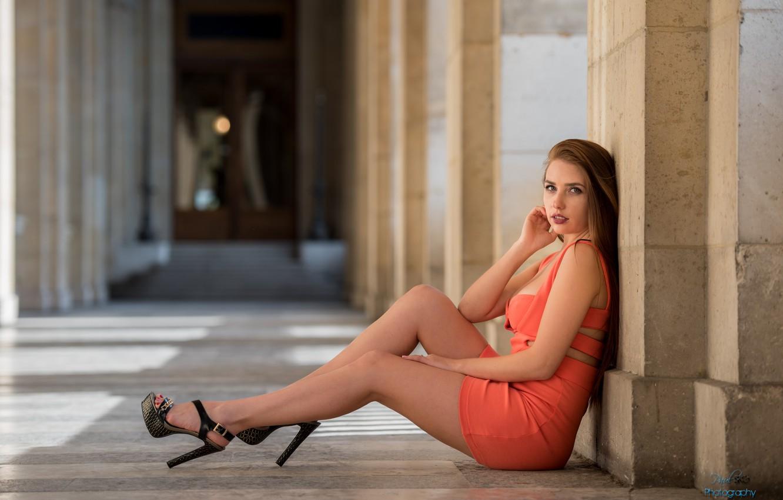 Photo wallpaper girl, the city, red, dress, brunette, columns, heels, sitting