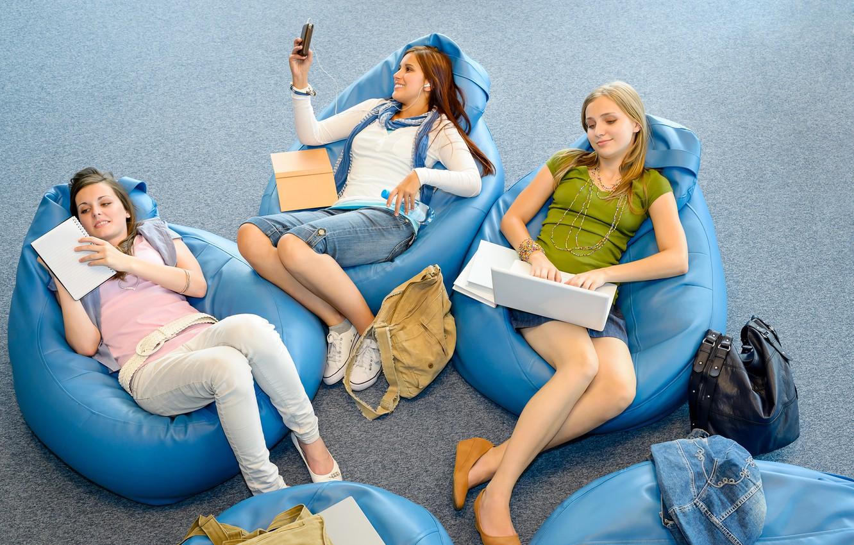 Photo wallpaper girls, mood, books, headphones, chairs, three, laptop, notebook, sitting, poses, backpacks, leisure
