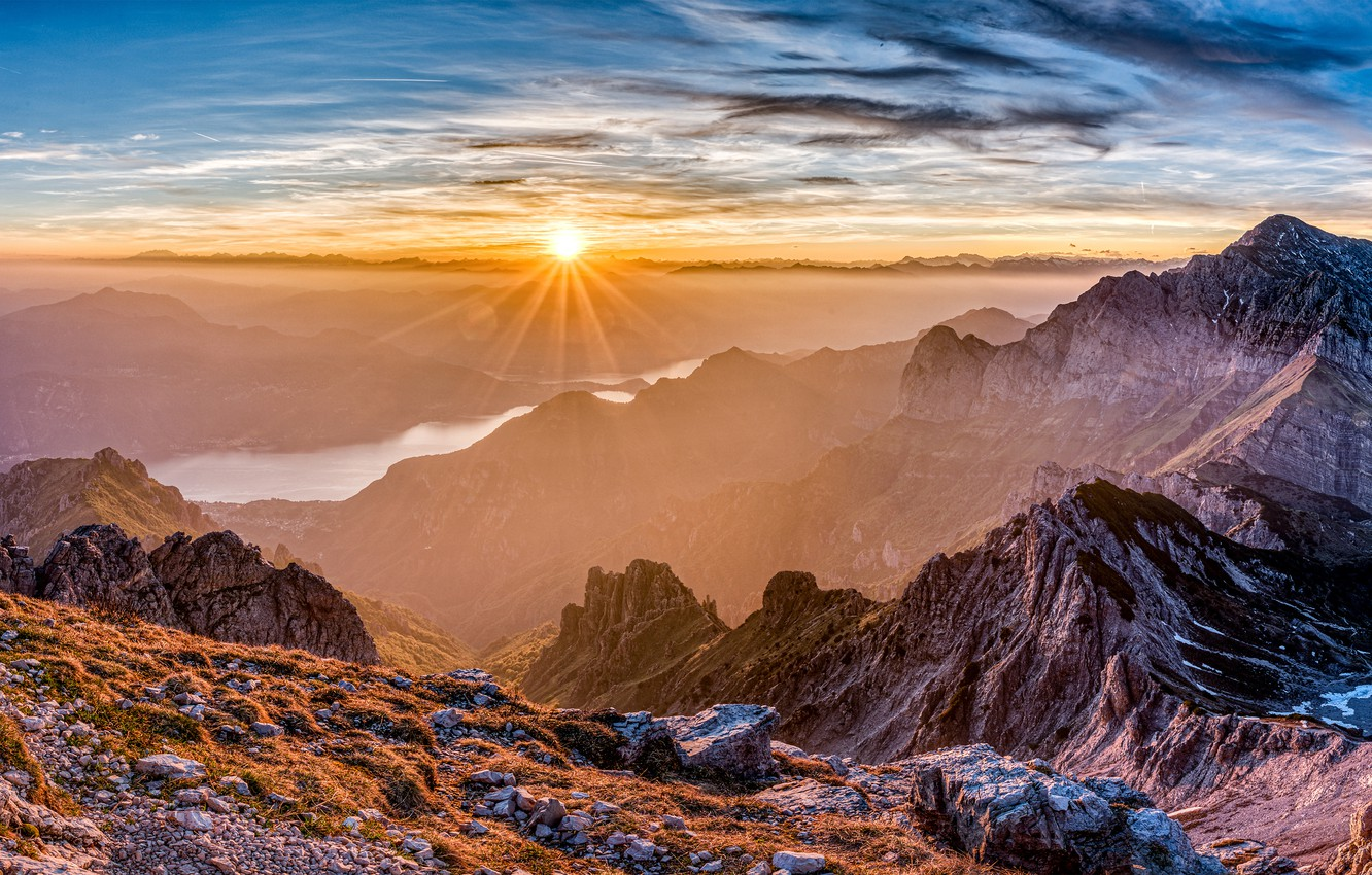 Photo wallpaper the sky, the sun, clouds, rays, mountains, river, stones, rocks, France, panorama, haze, hill, Pyrenees