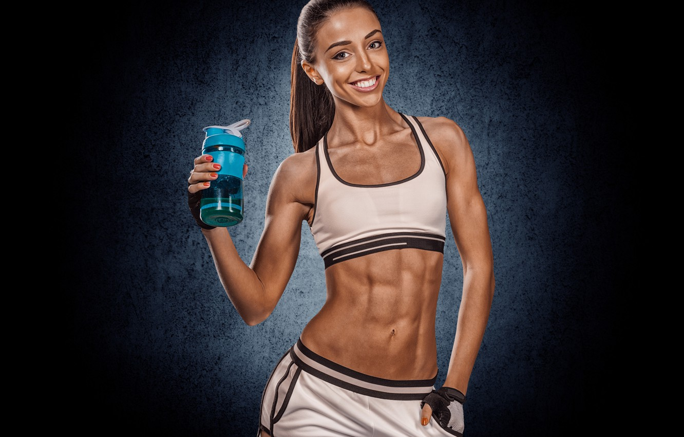 Photo wallpaper girl, pose, smile, background, sport, bottle, makeup, figure, hairstyle, gloves, shorts, sports, brown hair, fitness, …