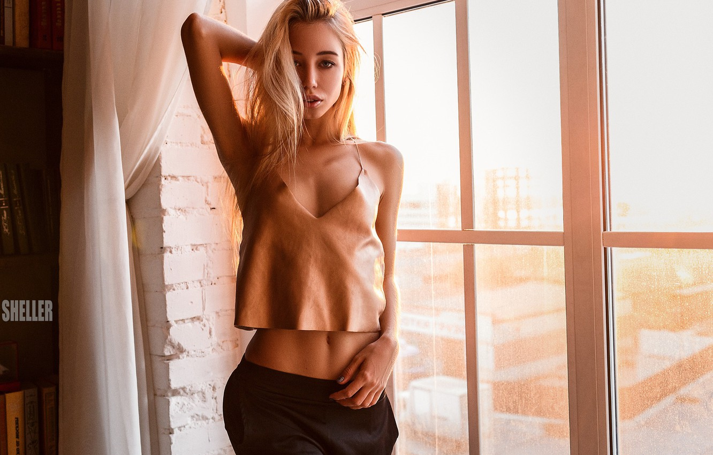 Photo wallpaper girl, wall, photo, photographer, bricks, model, bokeh, window, lips, blonde, belly, tummy, hips, portrait, pants, …