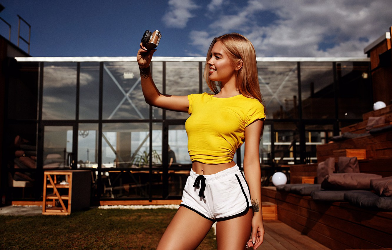 Photo wallpaper girl, shorts, long hair, legs, photo, photographer, camera, model, tattoo, blonde, belly, smiling, t-shirt, tummy, …