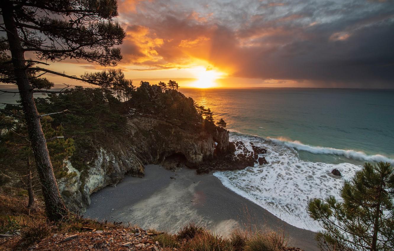 Photo wallpaper sea, the sky, the sun, clouds, trees, rocks, shore, horizon