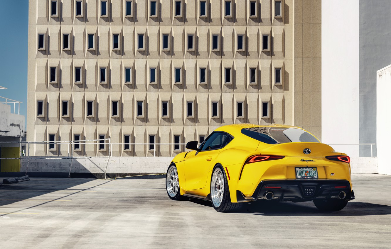 Photo wallpaper yellow, sports car, rear view, Toyota Supra, 2020 Toyota GR Above