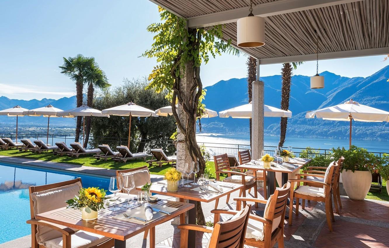 Photo wallpaper mountains, lake, stay, pool, Switzerland, cafe, umbrellas, the hotel, tables, Maggiore, Locarno, Villa Orselina Resort, …
