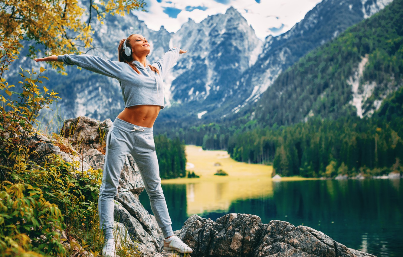Photo wallpaper girl, mountains, lake, headphones, fitness