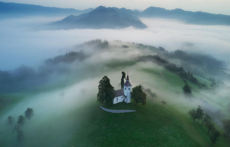 Photo wallpaper mountains, fog, hills, village, morning, Church, forest, meadows, Slovenia, Yamnik