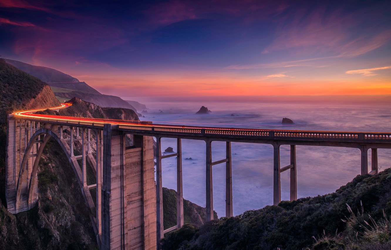 Photo wallpaper road, landscape, sunset, mountains, bridge, fog, the ocean, coast, CA, USA, Bixby Bridge