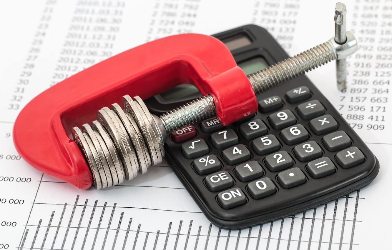 Photo wallpaper coins, calculator, savings, tighten the belt