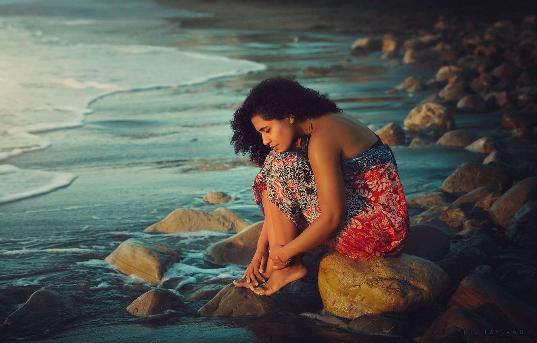 Photo wallpaper sea, girl, stones, shore, barefoot, brunette, curls, sundress, barefoot