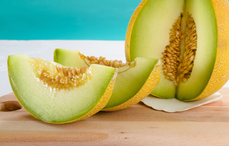 Photo wallpaper seeds, slices, melon