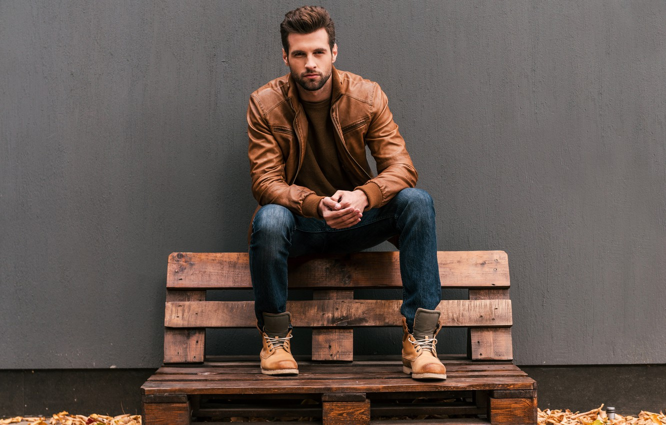 Photo wallpaper autumn, leaves, wall, portrait, jeans, shoes, jacket, t-shirt, male, guy, sitting, yellow, pallets