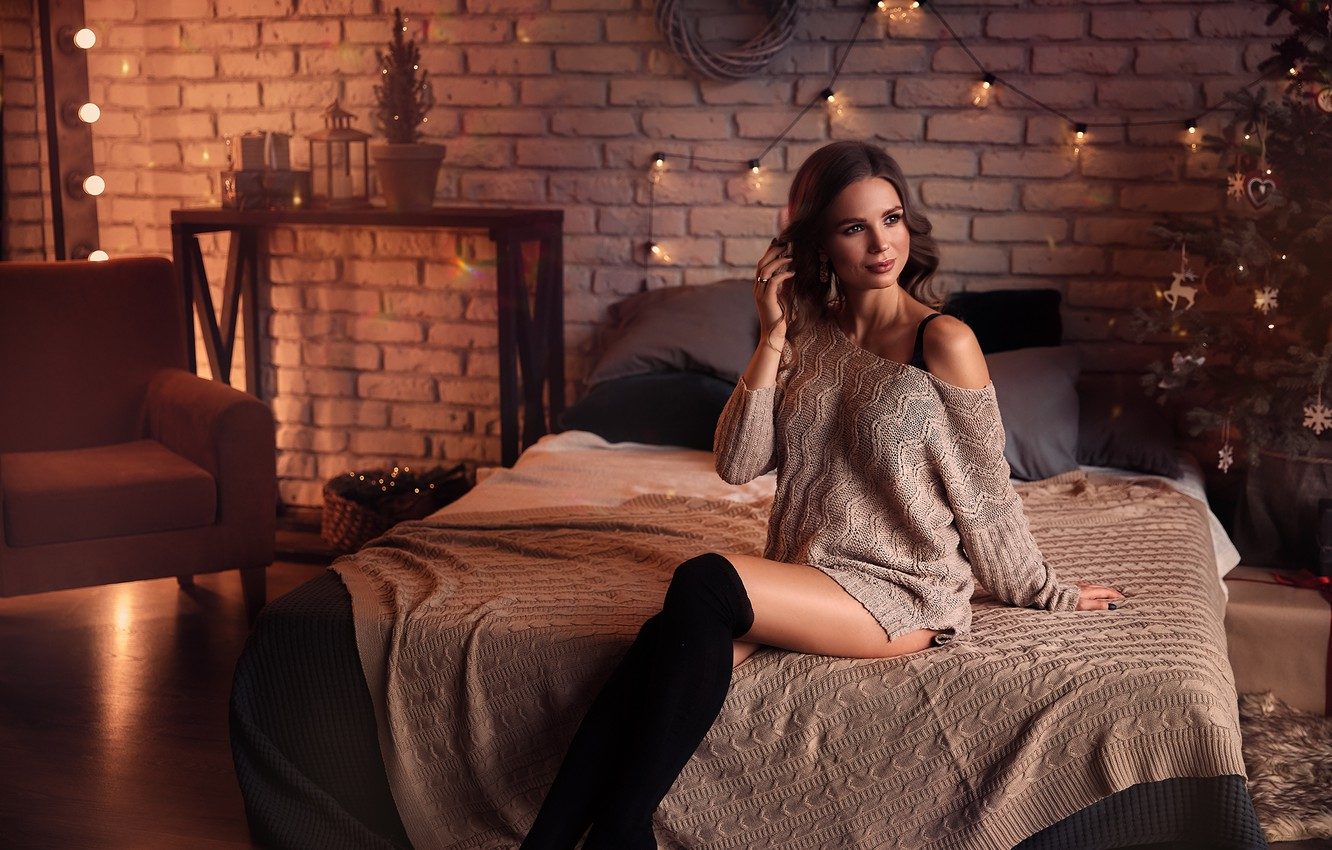 Photo wallpaper girl, room, bed, chair, stockings, brunette, tree, garland, shoulder, jumper, Anna Kuchinsky