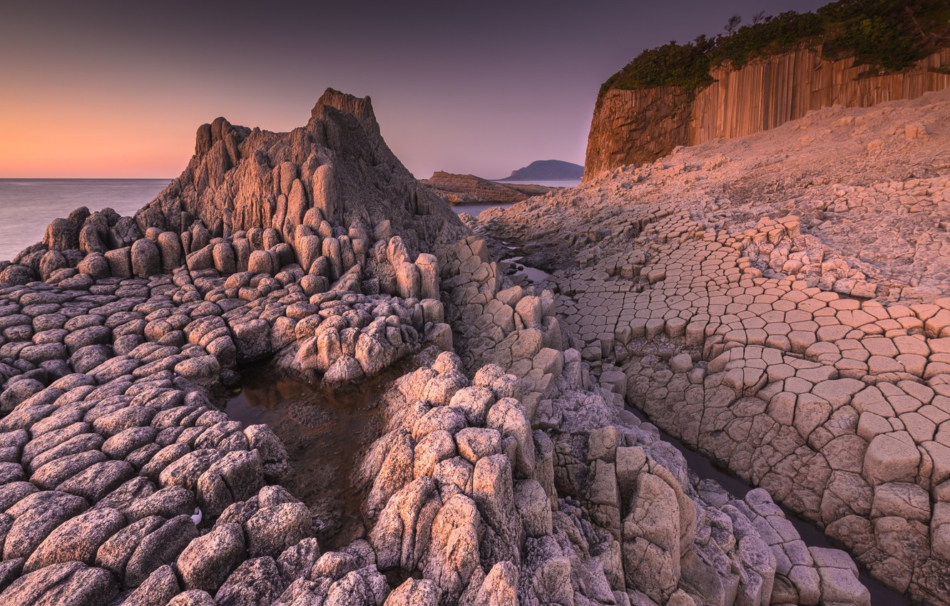 Photo wallpaper sea, the sky, light, stones, shore, structure, the evening, relief, texture, rocky education, ancient fossilized …
