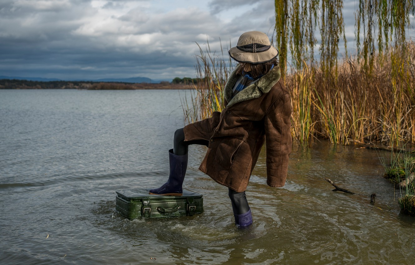 Photo wallpaper autumn, grass, girl, clouds, nature, pose, river, feet, the situation, hat, suitcase, is, coat, pond, …