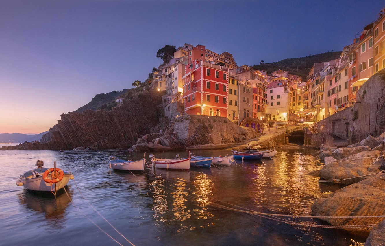 Photo wallpaper sea, sunset, stones, rocks, shore, home, boats, the evening, lighting, Italy, town, Italy, Riomaggiore, Riomaggiore, …