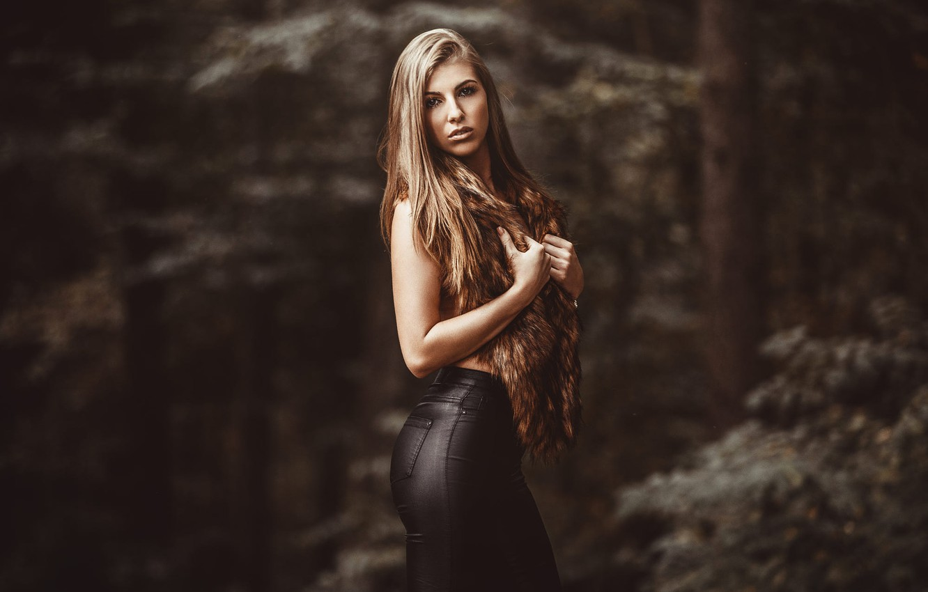 Photo wallpaper forest, look, trees, background, model, portrait, makeup, figure, hairstyle, fur, beauty, is, nature, pants, posing, …