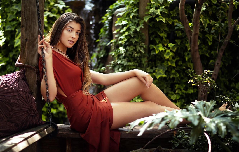Photo wallpaper look, girl, pose, portrait, makeup, garden, figure, dress, hairstyle, brown hair, legs, beautiful, sitting, in …