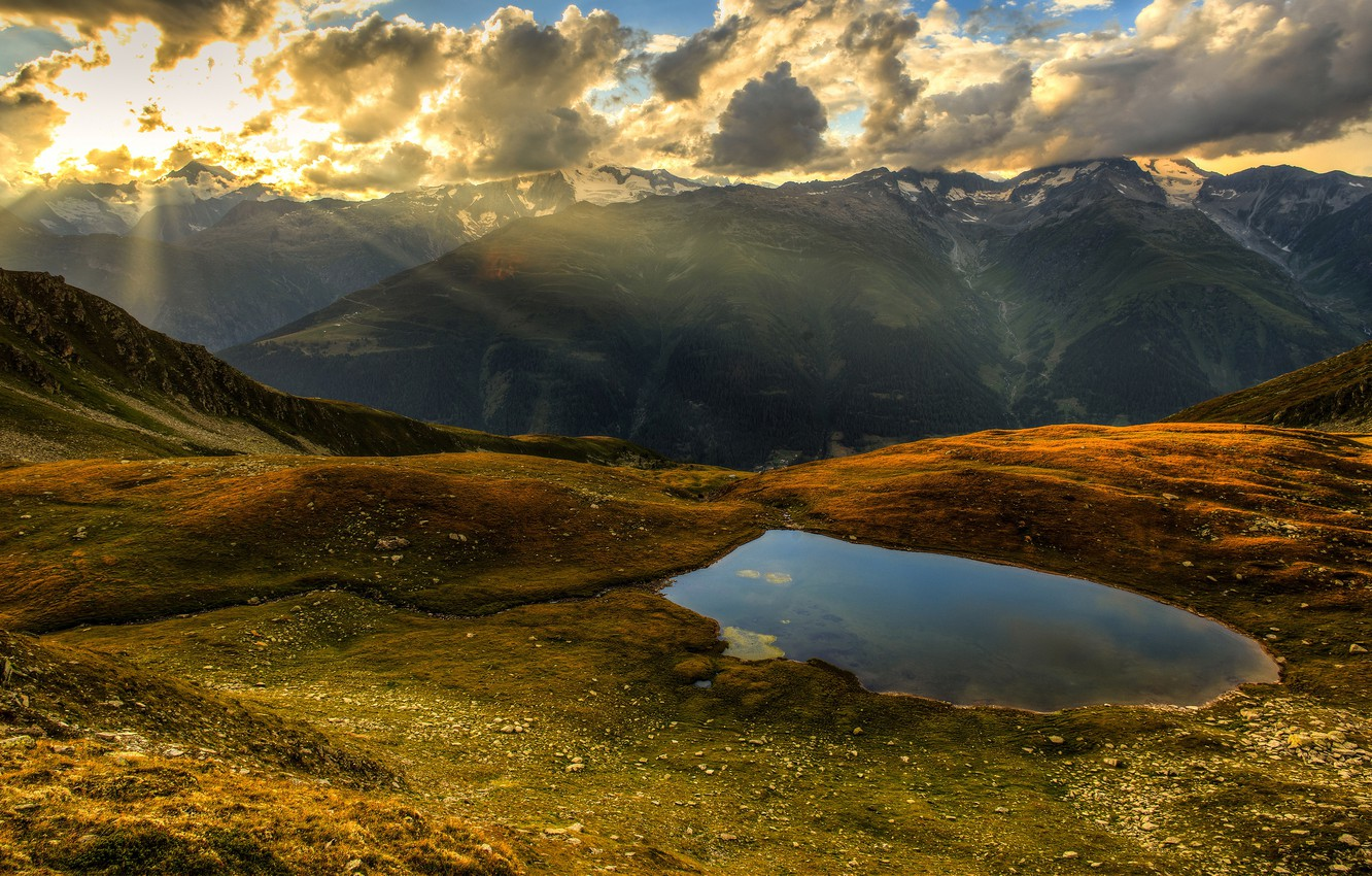Photo wallpaper autumn, forest, the sky, the sun, clouds, rays, light, mountains, fog, lake, stones, hills, the …