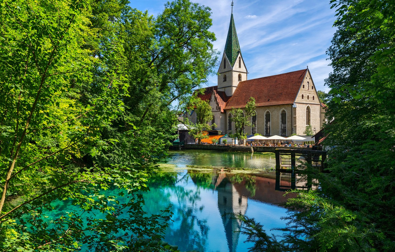 Photo wallpaper greens, the sky, the sun, trees, pond, Germany, Church, Blaubeuren
