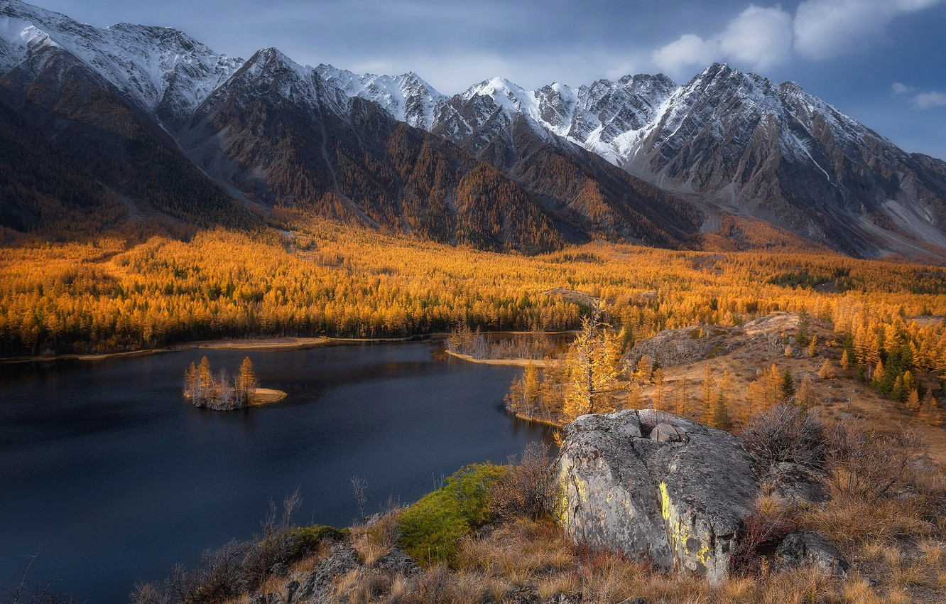 Photo wallpaper autumn, forest, the sky, clouds, trees, mountains, lake, stones, rocks, the slopes, tops, height, yellow, …