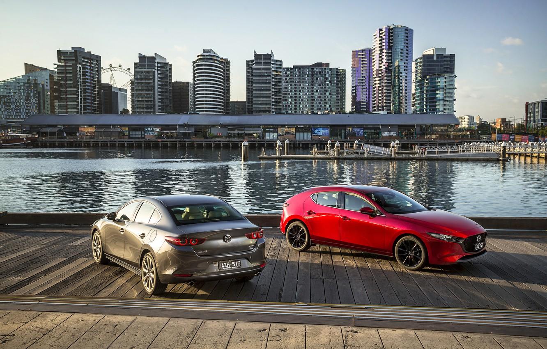 Photo wallpaper auto, river, skyscrapers, pier, Mazda
