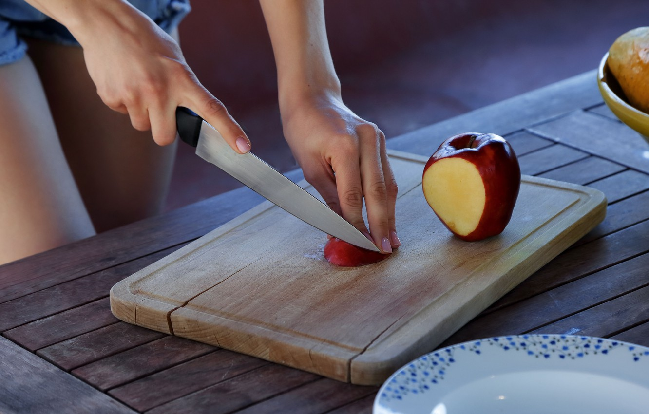 Photo wallpaper Apple, hands, knife, cutting board, wood table, slicing fruit
