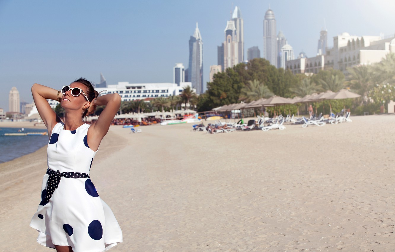 Photo wallpaper sand, sea, beach, girl, the sun, the city, shore, home, dress, glasses, bokeh