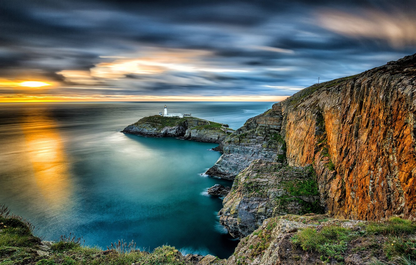Photo wallpaper sea, sunset, rocks, lighthouse, island, England, England, Wales, Wales, The Irish sea, Irish Sea, South …