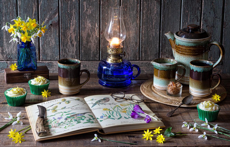 Photo wallpaper flowers, Board, lamp, glasses, snowdrops, knife, crocuses, Cup, book, still life, dessert, daffodils, coffee pot, …