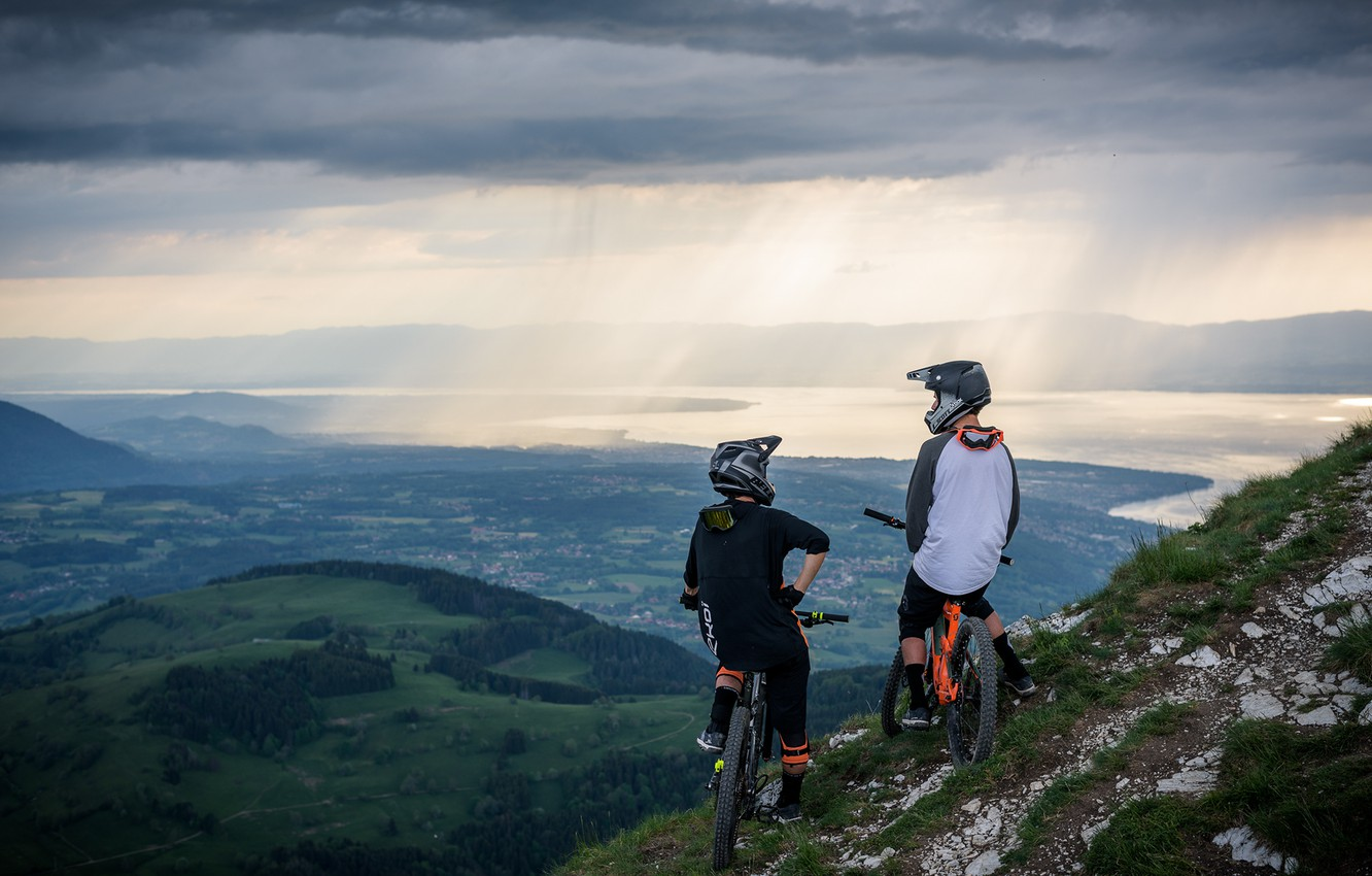 Photo wallpaper mountains, clouds, valley, cyclists, pond