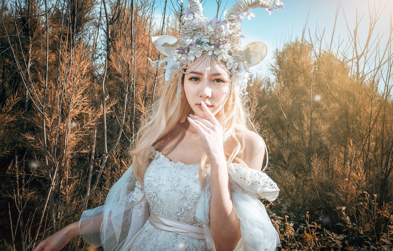 Photo wallpaper look, girl, light, decoration, branches, nature, face, pose, style, portrait, hands, fairy, blonde, costume, outfit, …
