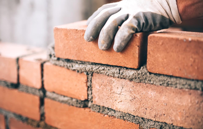 Photo wallpaper bricks, gloves, worker