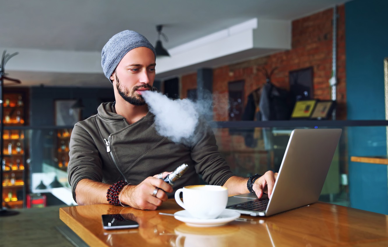 Photo wallpaper smoke, notebook, man, wool hat, cell phone, electronic cigarette