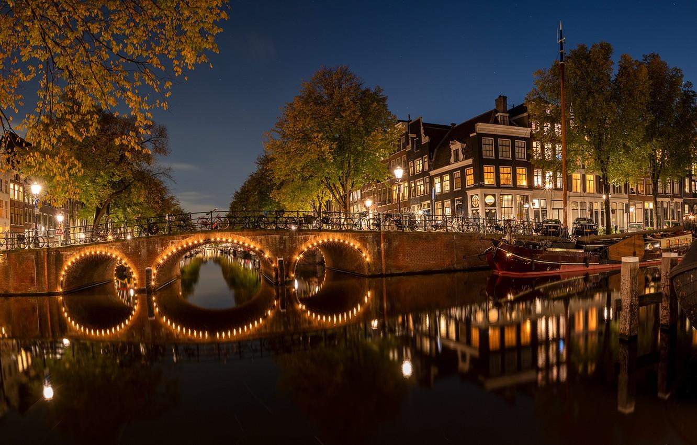 Photo wallpaper autumn, trees, night, bridge, the city, building, home, boats, lighting, Amsterdam, lights, channel, bikes, Holland