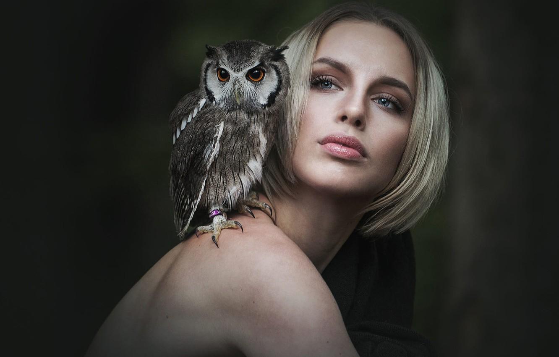 Photo wallpaper eyes, look, girl, face, the dark background, each, owl, bird, haircut, portrait, turn, blonde, friendship, …