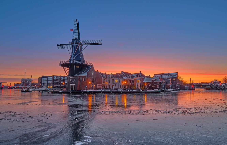 Photo wallpaper winter, sunset, river, building, home, mill, Netherlands, Netherlands, Haarlem, Haarlem, Spaarne River, The Guy Near …