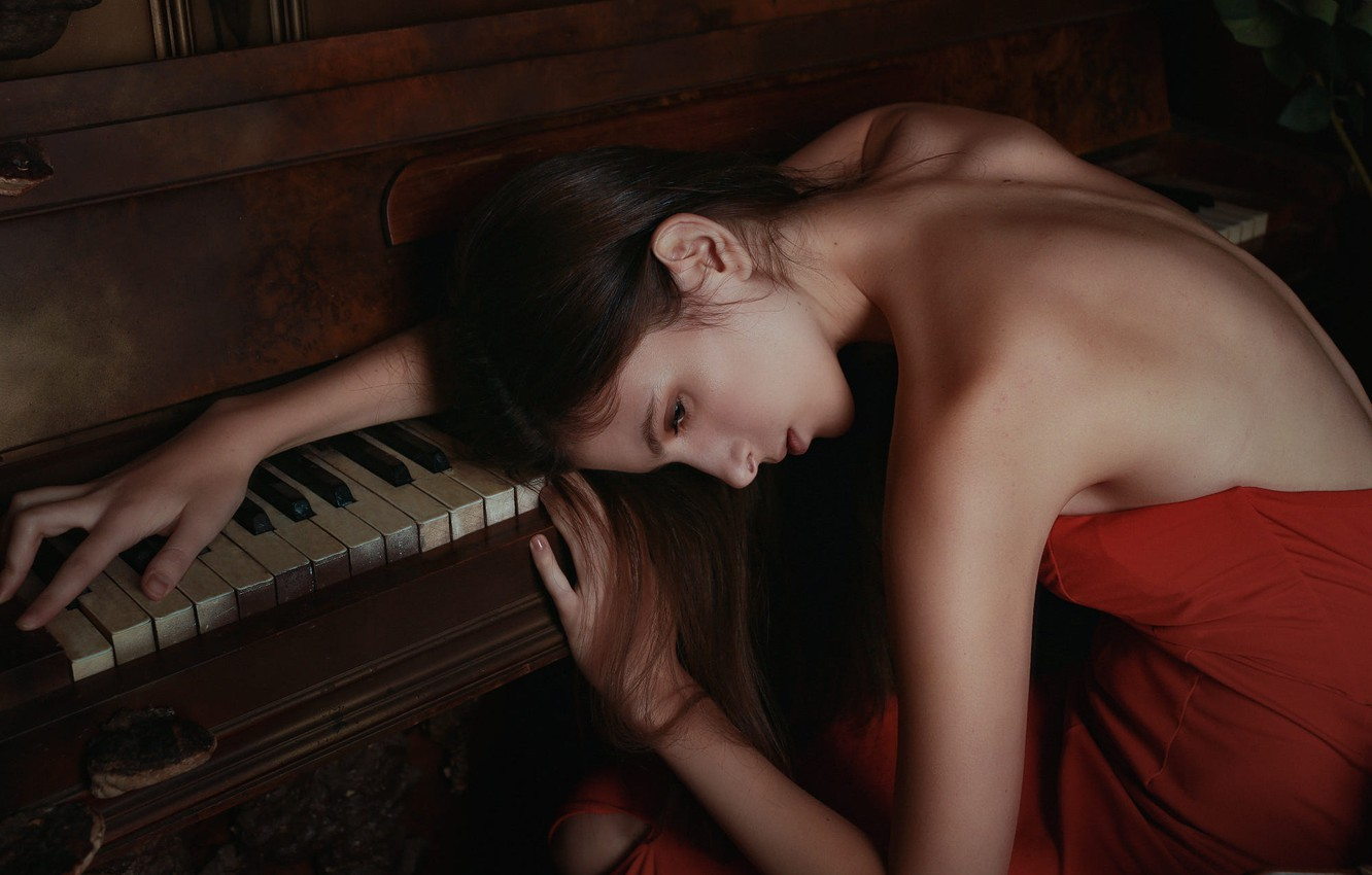 Photo wallpaper sadness, look, girl, face, pose, the dark background, mood, back, hands, brown hair, Nude, piano, …