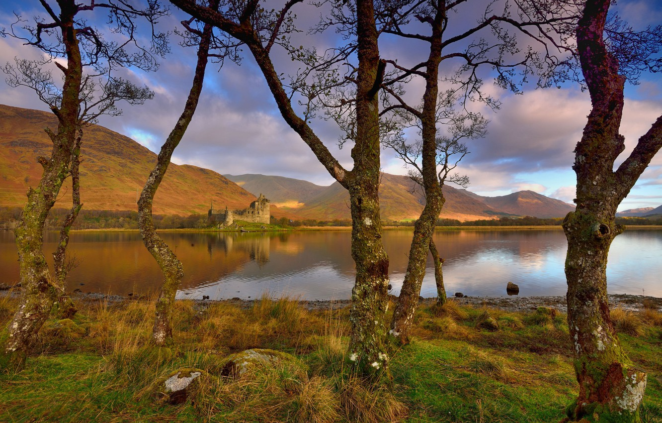 Photo wallpaper autumn, the sky, clouds, trees, mountains, branches, lake, reflection, blue, castle, hills, trunks, shore, Scotland, …