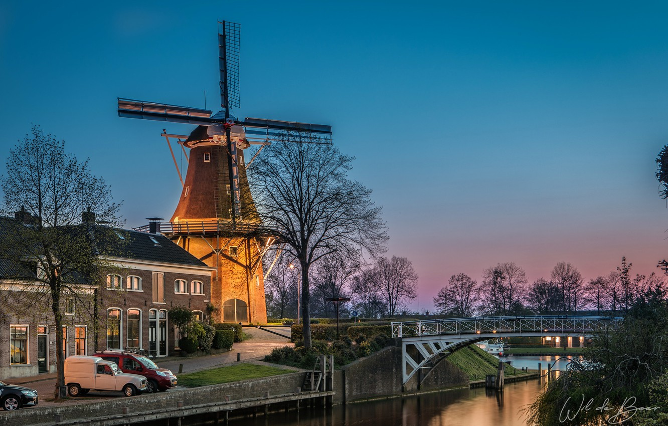 Photo wallpaper the sky, trees, machine, bridge, lights, house, river, the evening, mill, channel, Netherlands, the bushes, …