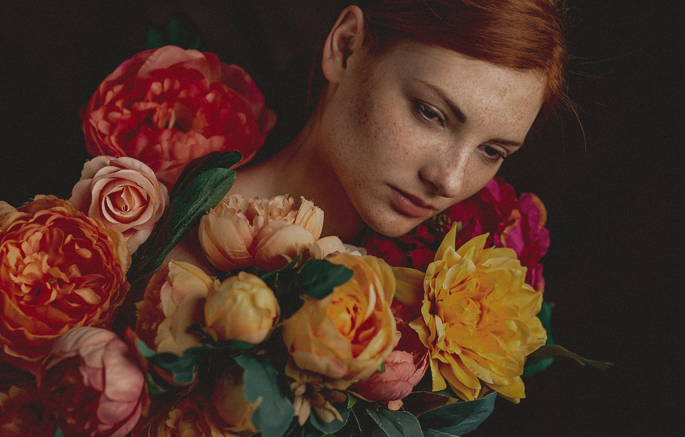Photo wallpaper girl, flowers, face, portrait, freckles, red, redhead, the dark background, freckled
