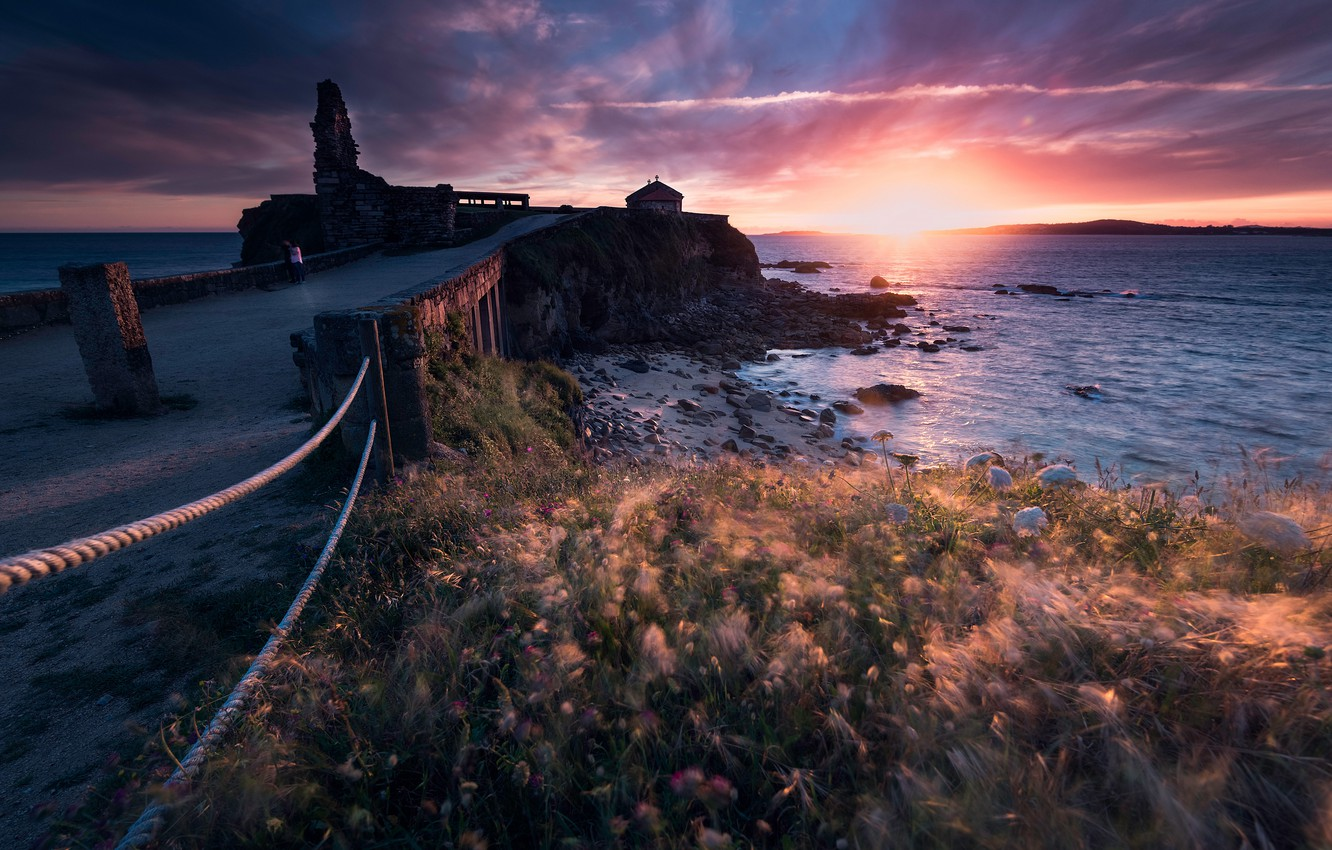 Photo wallpaper road, sea, the sky, grass, the sun, clouds, light, sunset, flowers, stones, rocks, the wind, …